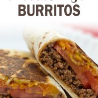 A burrito with ground beef, tomato slices, and melted cheese, cut in half on a white plate. Text toasted cheeseburger burritos add salt & serve formerly menus4moms