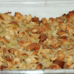 White baking dish with baked cornbread stuffing