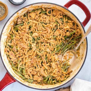 Skillet with green bean casserole topped with crunchy fried onions