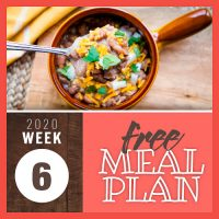 Overhead view of pinto beans in a crock topped with shreadded cheddar cheese, chopped cilantro and chopped onions with a spoonfull scooped out; text Free meal plan 2020 week 6
