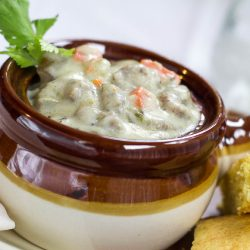 Crockpot Creamy Bratwurst Stew in a brown and white soup bowl.
