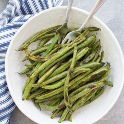 A bowl of roasted green beans