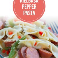 A plate of sliced bell peppers and sausauge and bow-tie pasta with text Kielbasa Pepper Pasta - Add Salt & Serve logo