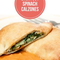 Spinach calzones on a plate with spaghetti sauce; text is Shortcut Spinach Calzones - Add Salt & Serve logo
