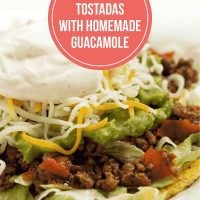 A plate with beef tostadas made with guacamole, shredded cheese, and sour cream. Text is Easy Beef Tostados with Homemade Guacamole - Add Salt & Serve logo