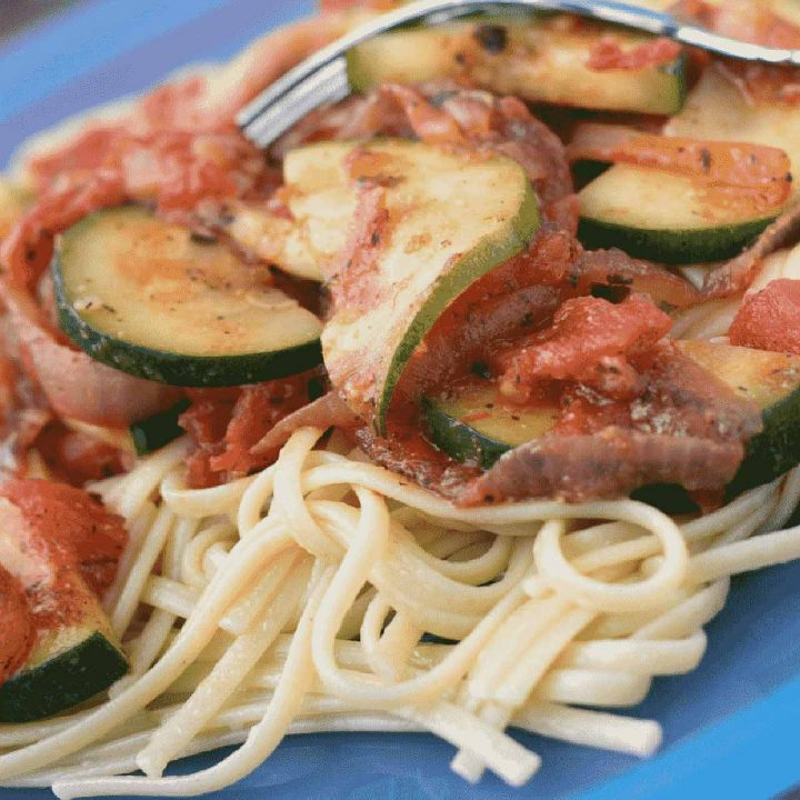 Linguini in a tomato sauce with sliced zucchini