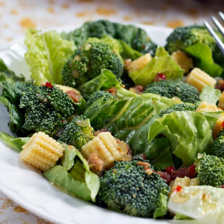 Baby Corn Salad with Broccoli on a plate with a fork.