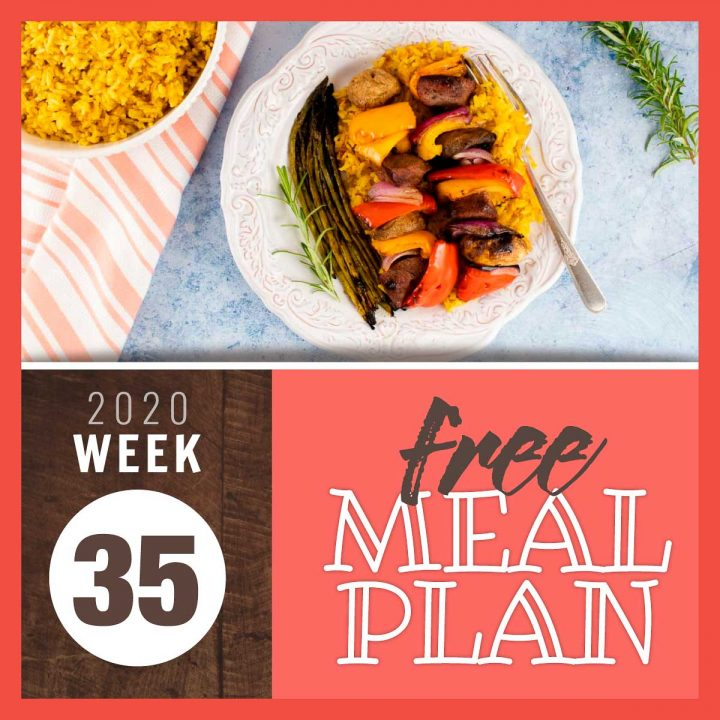 Overhead view of beef and vegetable kabobs with grilled asparagus and text Free Meal Plan week 35 2020
