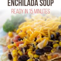 Corn and black beans topped with shredded cheddar cheese on a bed of tortilla chips on a white plate with text Quick Stovetop Enchilada Soup Ready in 15 Minutes - Add Salt & Serve logo