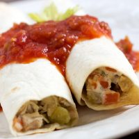 Two Tex Mex Chicken Roll Ups topped with salsa