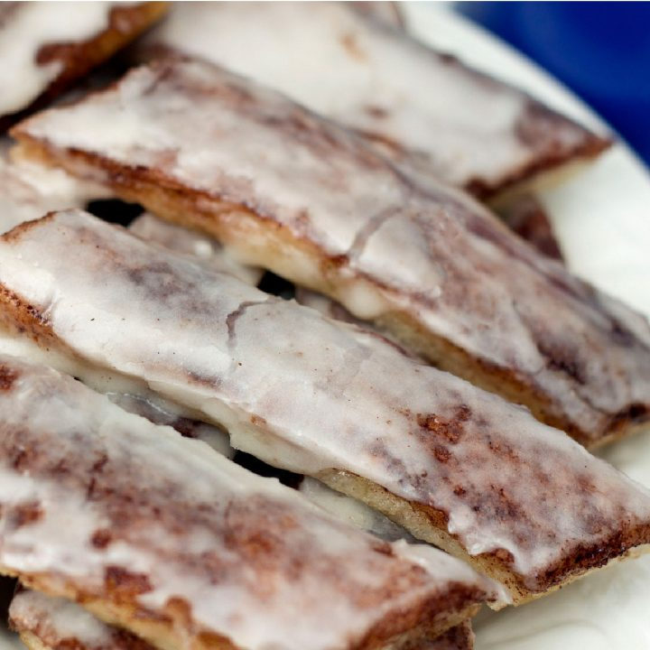 Pizza dough cinnamon sticks with frosting