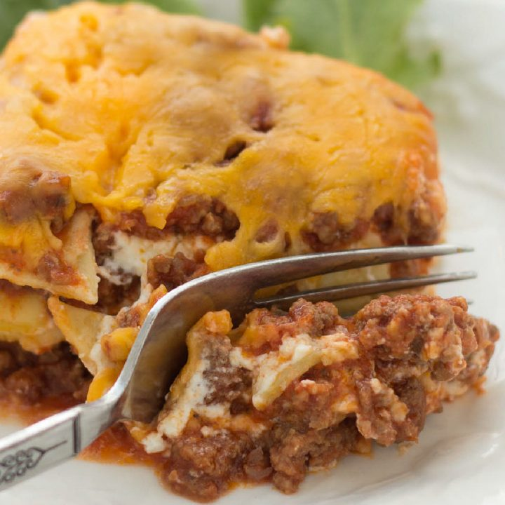 A slice of Layered Italian Beef Casserole being cut by a fork