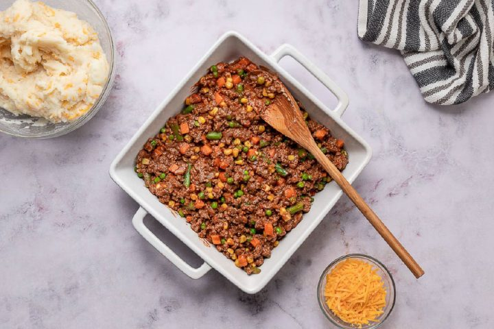 beef and vegetable mixture for shepherd's pie in a baking pan
