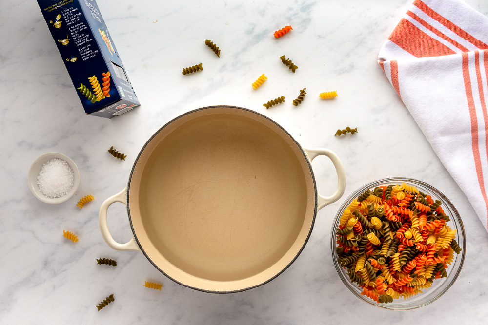 pan with water and a bowl of rotini