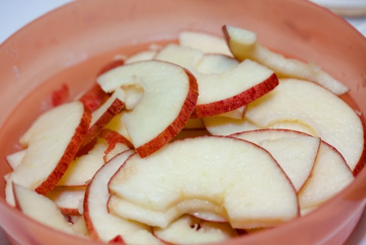 Bowl of sliced apples and text Add Salt & Serve