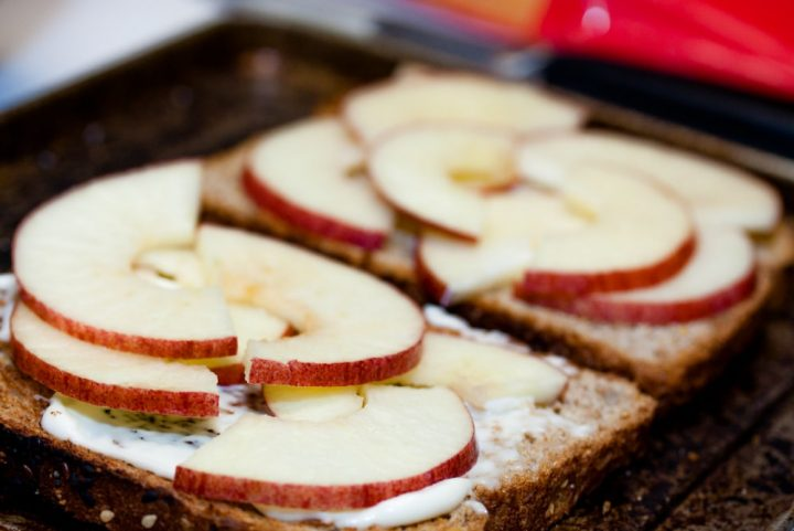Toast with mayo and sliced apples and text Add Salt & Serve