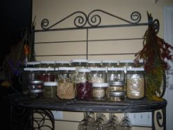 Bakers rack with glass jars filled with dried beans