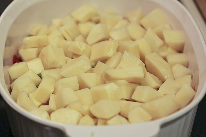 Chopped potatoes in a casserole dish